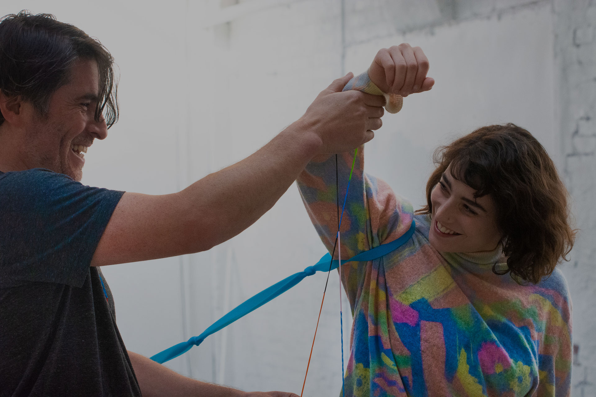 Resistance band training smiling student and instructor