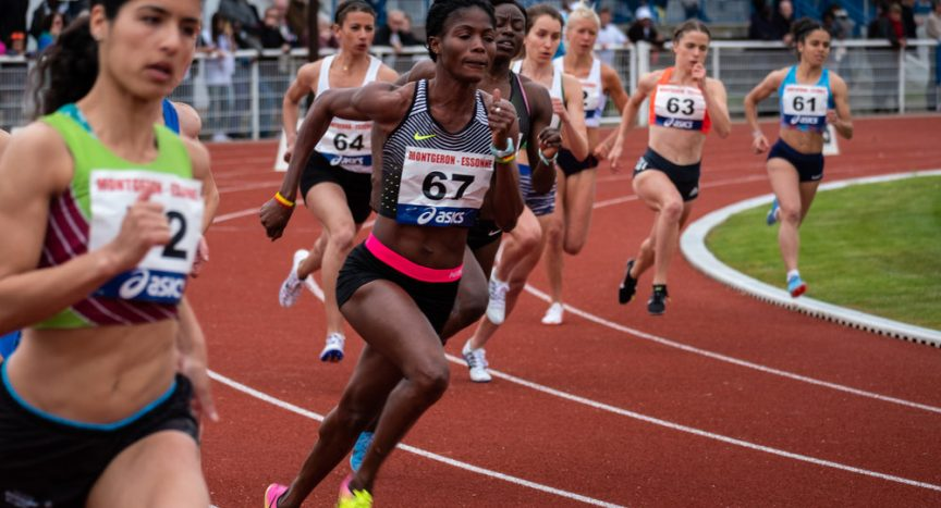 Female sprinters during mid race
