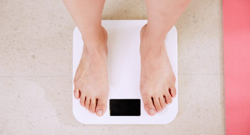 Someone standing on bathroom scales